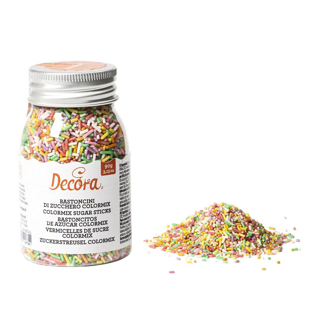 DecoraZucker, der direkt auf Kuchen, Cupcakes und Kekse gestreut wird. Hergestellt aus natürlichen Extraktionsfarbstoffen.