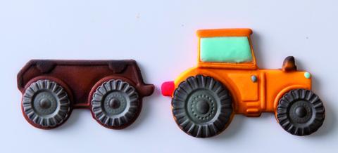 Ausstecher Traktor mit Anhänger