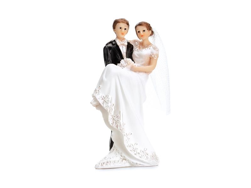 Brautpaar mit getragener Braut