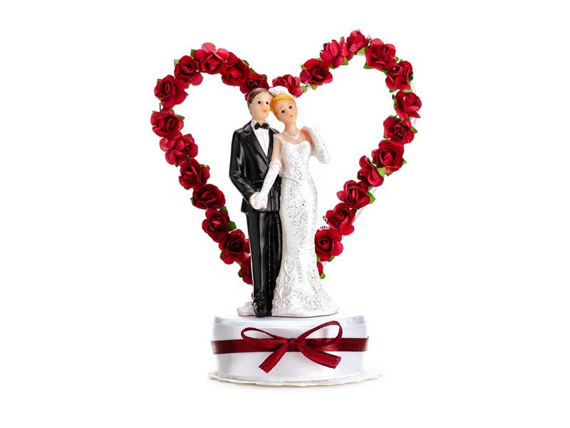 Brautpaar mit Herz aus roten Rosen